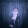 Thoughtful businessman looking at binary code — Stock Photo #63149165