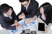 Business team pointing at pie chart — Stock Photo
