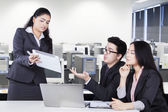 Businesspeople discussing something with tablet — Stock Photo