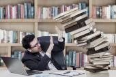 Caucasian businessman with books — Stock Photo