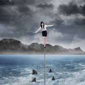 Female entrepreneur in risk concept — Stock Photo