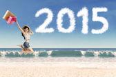 Girl holding shopping bag jump on beach — Stock Photo