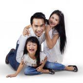 Joyful family playing in the studio — Stock Photo