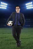 Male manager with football at field — Stock Photo