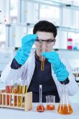 Male scientist doing research in laboratory — Stock Photo