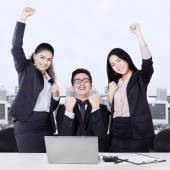 Successful business team celebrating with arms up — Stock Photo