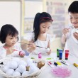 Children painting eggs — Stock Photo #63843357