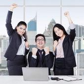 Cheerful multicultural team celebrate success — Stock Photo
