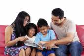 Parents read a story book for children — Stock Photo