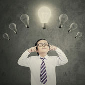 Boy concentrate to make idea — Stock Photo