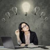 Chinese manager with lamp over head — Stock Photo