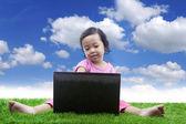 E-learning for girl under blue sky — Stock Photo