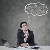 Male employee imagines his dreams — Stock Photo