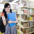 Young high school student in library — Stock Photo #64281705