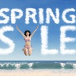 Beautiful model forming spring sale text — Stock Photo #64904113