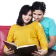 Man read a book with pregnant wife — Stock Photo #64915897