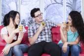 Multiracial teenager drinking beer on sofa — Stock Photo