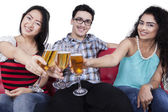 Teenagers having fun by drinking champagne — Stock Photo