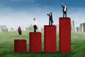 Business team standing on business chart 1 — Stock fotografie