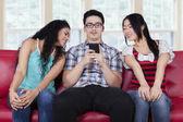 Caucasian man with curious girls — Stock Photo