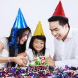 Portrait of asian family cutting a cake — Stock Photo #65599499