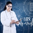 Doctor with futuristic interface writes prescription — Stock Photo #65592577