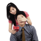 Chinese woman giving surprise to boyfriend — Stock Photo