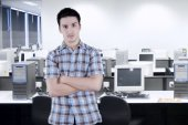 Handsome casual manager in office — Stock Photo