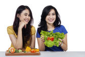 Friendly girls with vegetables salad — Stock Photo