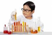 Little scientist holding beaker — Stock Photo
