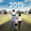 Happy family walk on the road to future — Stock Photo #66182103