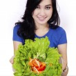 Pretty asian woman showing salad — Stock Photo #66184375