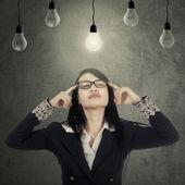 Entrepreneur seek idea under bulbs — Stock Photo