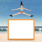 Healthy woman jumping over copyspace — Stock Photo