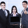 Asian business team showing blank screen on laptop — Stock Photo #67120657