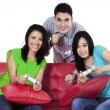 Joyful people playing games with joystick — Stock Photo #67122239