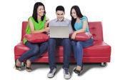 Happy teenager browsing internet online — Stockfoto