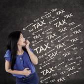 Worried female entrepreneur with tax pressure — Stock Photo