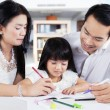 Girl learn to write with parents — Stock Photo #67465227