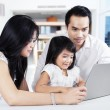 Girl studying with laptop and her parents — Stock Photo #67465285
