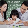 Little girl studying with parents at class — Stock Photo #67467089