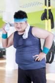 Obesity person wiping his sweat at gym — Stock Photo