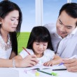 Parents help their child to write — Stock Photo #67470195