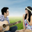 Romantic guy playing guitar for his girlfriend — Stock Photo #67470937