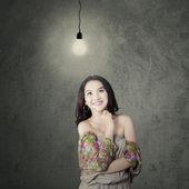 Attractive modern teenage girl under lamp — Stock Photo