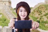 Beautiful brunette girl taking selfie — Stock Photo