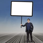 Business manager holding empty board — Stock Photo