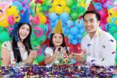 Cheerful family celebrating birthday party — Stock Photo