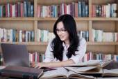 Clever teenage girl learn in the library — Stock Photo