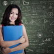 Female college student smiling in the class — Stock Photo #68172151